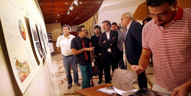 Las autoridades recorren la exposición 'Las tierras del Athalian' que se puede ver en el hall del Gran Teatro hasta el domingo. / PABLO LORENTE
