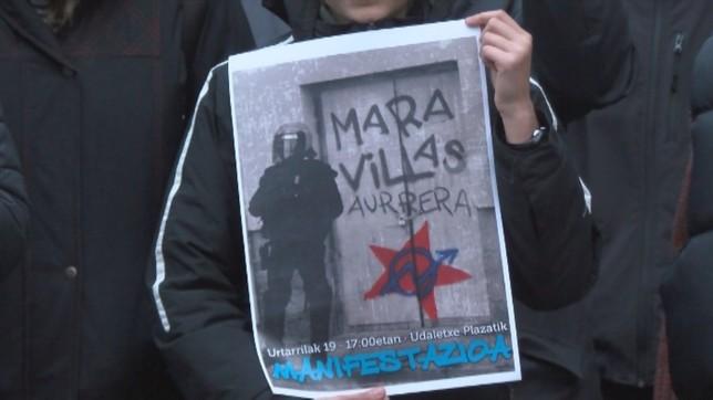 Uno de los carteles que portaban los jóvenes del Gaztetxe Maravillas NATV