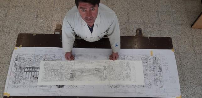López Saura junto a los bocetos que utilizó para la obra. S.A.