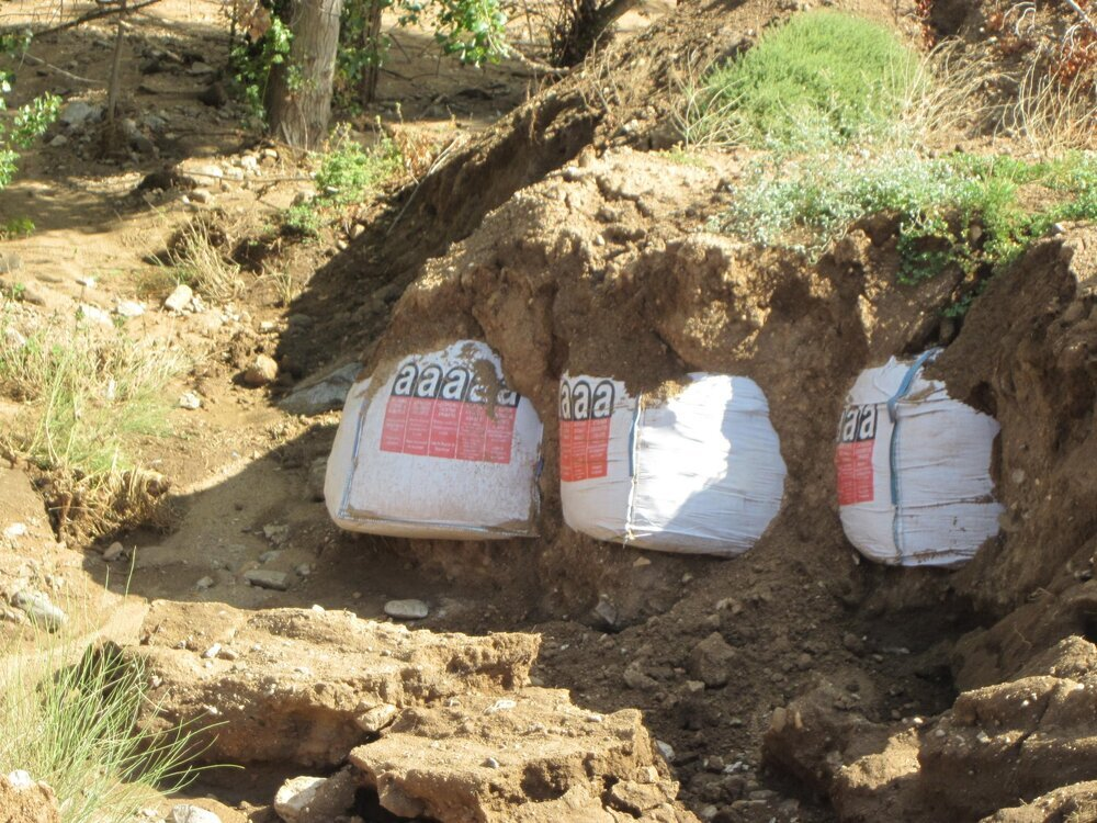 La riada en Ramabujas arrastra y hace aflorar el amianto