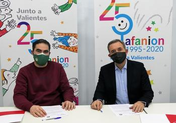 Los presidentes de ambas entidades, durante la firma del acuerdo.