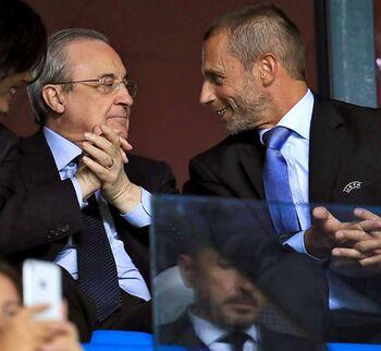 El presidente del Real Madrid, junto al líder de la UEFA, Aleksander Ceferin.