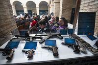 El jefe superior de policia Felix Antolin, junto al Comisario Provincial Miguel rufino, inaguran la exposición de la policia nacional, en la que se muestran, bombas lapas, fiambreras con goma dos, pistolas de ETA, y el rifle con el que pretendian atentar